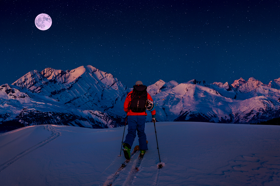 Night ski with amazing view of swiss famous mountains in beautif